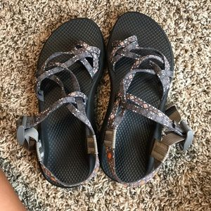 Gray chacos with orange accents